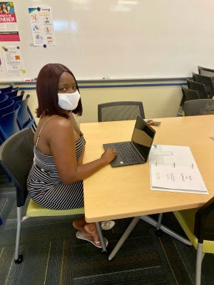 Jamara James was one of 10 clients who participated in Tech to Connect, a pilot program by the Women's Resource Center and Goodwill Manasota to connect participants with laptops upon completion of digital literacy training.