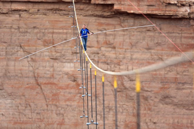 ORG XMIT: CPA701 IMAGE DISTRIBUTED FOR DISCOVERY COMMUNICATIONS - Nik Wallenda walks across a 2-inch wire 1500 feet above the ground to cross the Grand Canyon for Skywire Live With Nik Wallenda on the Discovery Channel, Sunday, June 23, 2013 at the Grand Canyon, Calif. (Tiffany Brown/AP Images for Discovery Communications)