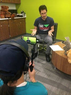 Jose Cruz, a children's librarian at the Shannon Staub Library in North Port, broadcasts live storytimes on the Sarasota County Play Facebook page.