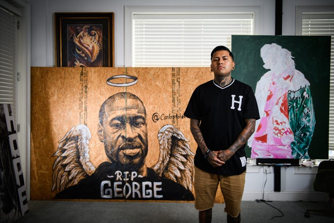 Artist Carlos Tolentino did a painting of George Floyd that was displayed on Hay Street after the George Floyd marches in downtown Fayetteville. Tolentino is donating the painting to Fayetteville State University.