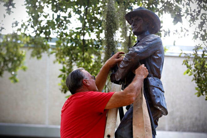 An employee prepares to remove the Confederate monument, known as Old Joe, in downtown Gainesville in 2017.