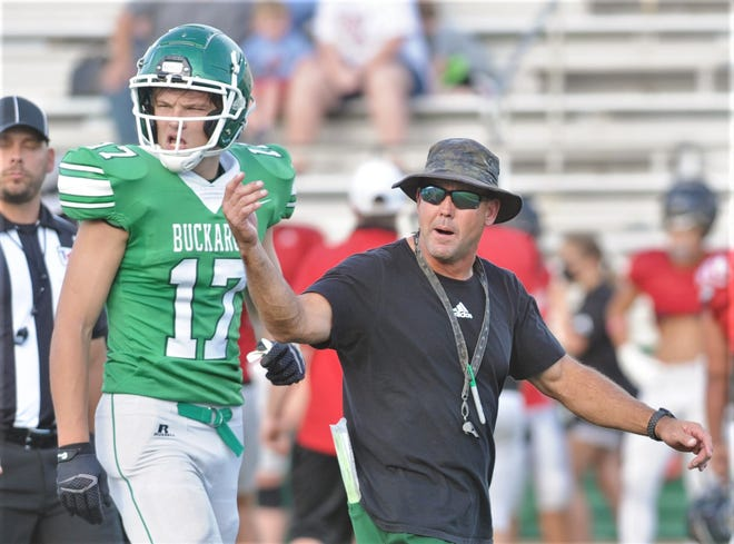 Casey Pearce, shown here with player Logan King during a scrimmage against Mineral Wells last season, was thrilled with his team's 49-28 victory over Jacksboro in the Buckaroos' season opener Friday at Buckaroo Stadium. The Bucks didn't score until the fourth game of the season last year and finished 1-8 in Pearce's first year with the program.