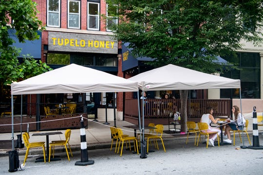 Outdoor dining for Tupelo Honey, 12 College St,, has been expanded onto the street n front of the restaurant downtown.
