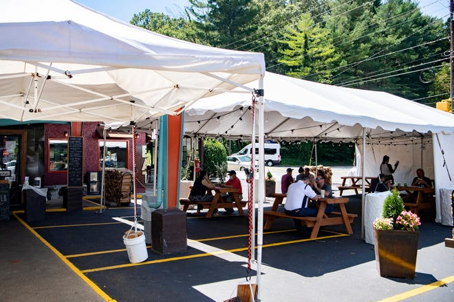 A new tent turns parking spaces into outdoor dining at Luella's Bar-B-Que, 501 Merrimon Ave, on Aug. 18, 2020.