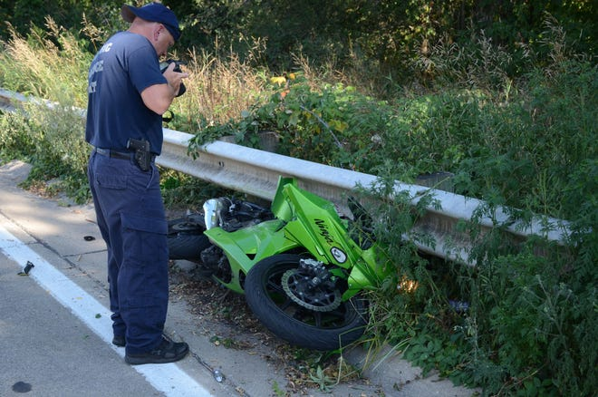 A motorcyclist was killed Friday when his bike collided with a car on Columbia Avenue.  Trace Christenson/The Enquirer