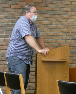 Brentwood Drive resident Matt Rindfuss voices his opposition to a proposed apartment building off of Friendship Drive, behind his home, during Thursday's Bucyrus City Council joint committee meeting.