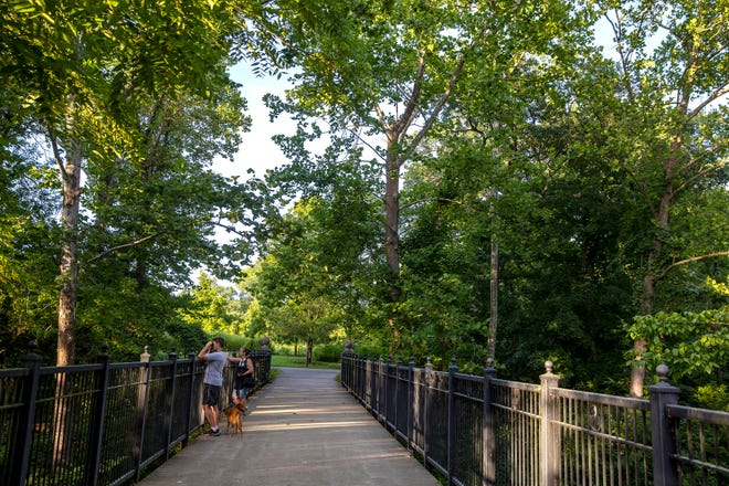 People take in the scenery at Glenwood Gardens on Thursday, August 20, 2020.