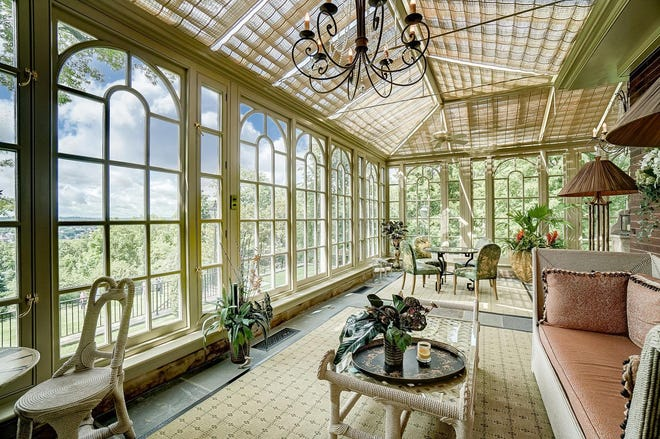 This house in East Walnut Hills recently hit the market for $3 million. It features its own conservatory imported from England.
