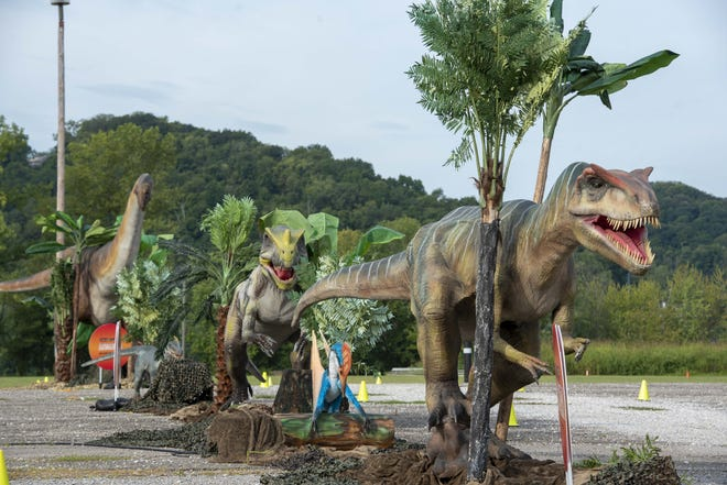File - Jurassic Quest brought over 70 true-to-life size dinosaurs and prehistoric creatures including a 50-foot moving animatronic Megalodon to Coney Island. The drive-thru show runs until Aug. 30.