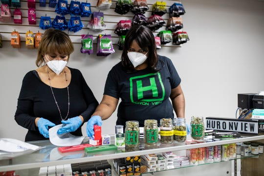 Christina Montague and her daughter Teesha Montague fill an order at Huron View Dispensary in Ann Arbor on August 20, 2020.
