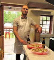 Krzysztof Krol with two of pierogi plates he serves at his new Prince of Pierogi restaurant in Ephraim.