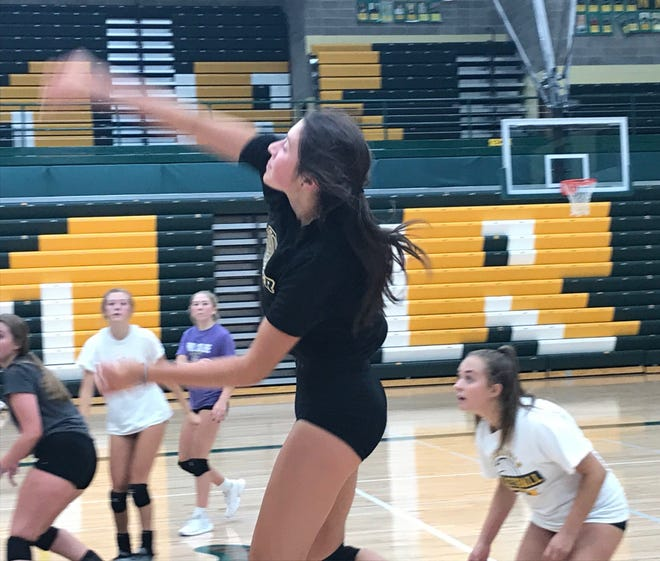 Lauren Lindseth goes high at the net for a kill attempt as the former C.M. Russell libero works on a new position for the 2020 prep volleyball season.