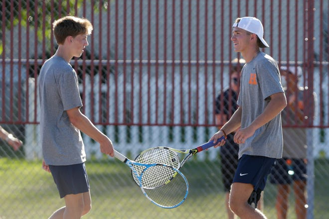 Harrison's Ronan Clary and Max Jacobsen tap rackets after defeating West Lafayette's Kevin Ziang and Frank Shi during an IHSAA tennis doubles match, Thursday, Aug. 20, 2020 in West Lafayette.