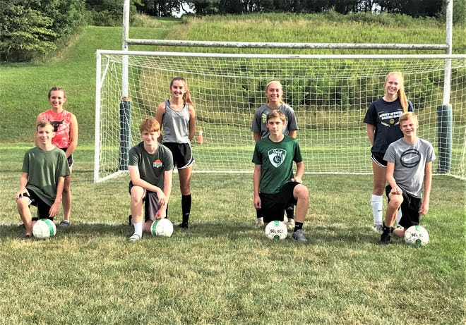 Four set of brothers and sisters play on the Fisher Catholic boys and girls' soccer teams. They are from left to right: Nathan and Abbey Krile, Caden and Cora Anders, J.J. and Anastacia Viau and Mitchell and Mallory Ortiz.