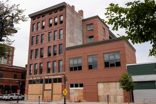 The building at 209 E. Main St. had a fire break out on the roof Friday morning. The space is planned for a new gaming center, but the fire may postpone those plans.
