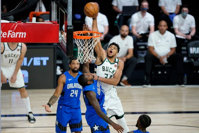 Milwaukee Bucks forward Giannis Antetokounmpo scores over Orlando Magic forward Gary Clark during the NBA playoffs. To her surprise, Journal Sentinel summer news intern Asha Prihar, never much for sports before, found herself becoming a Bucks fan during her internship.