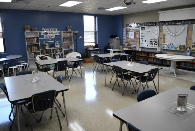 This classroom at Mountain Home's Hackler Intermediate breaks the classroom down into smaller, four-student groups. Schools across Arkansas will begin returning to in-campus instruction on Monday.