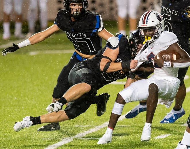 Catholic linebacker Patrick Ryan (9)stops Pike Road quarterback Iverson Hooks (2) during the AHSAA Kickoff Classic at Cramton Bowl in Montgomery, Ala., on Thursday evening August 20, 2020.