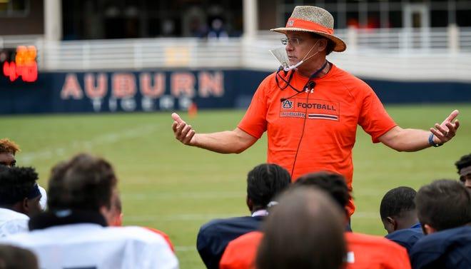Auburn coach Gus Malzahn addresses the team during practice on Thursday, Aug. 20, 2020 in Auburn, Ala.