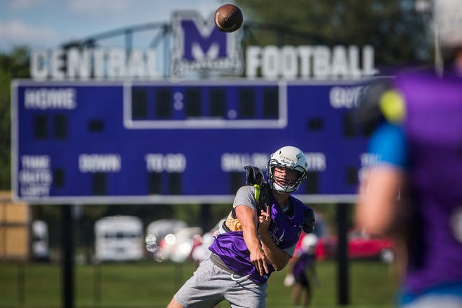 Central senior quarterback Max Pittman throws a football during practice at Muncie Central High School Wednesday, Aug. 19, 2020.