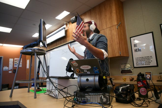 Alex Jackson, English teacher at Indio High School, teaches his class virtually on the second day of the school year, Thursday, August 20, 2020, due to COVID-19 in Indio, Calif.