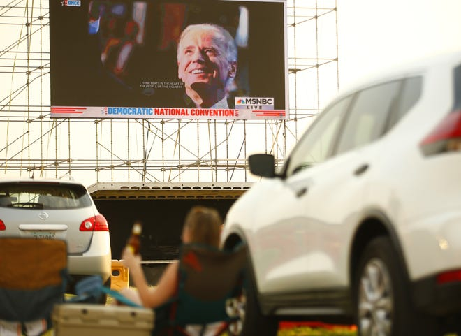 Arizona delegates park their cars to watch the big screen during an Arizona Democratic Party drive-in night to watch the acceptance speech of their party's nominee, Joe Biden, in Mesa, Ariz. on August 20, 2020.