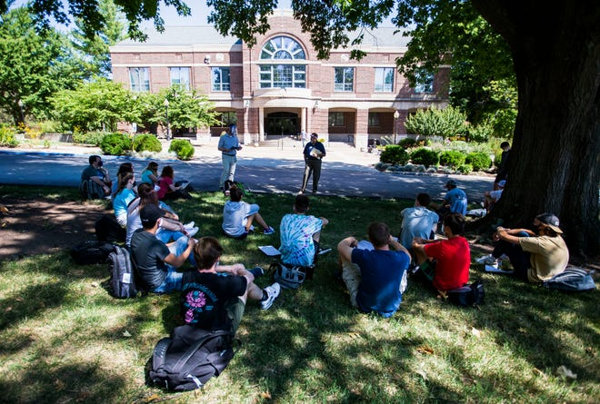 A class meets outside at Drury University on Friday, Aug. 21, 2020.