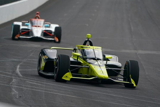 Charlie Kimball drives into the first turn during practice for the Indianapolis 500 at Indianapolis Motor Speedway on Aug. 12.