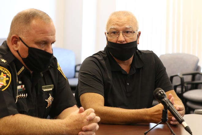 Mark Ross, right, who spent nearly 40 years with the Muskingum County Sheriff's Office, has bee named the police chief of the South Zanesville Police Department. At left is Sheriff Matt Lutz, who said Ross brings a wealth of experience to the South Zanesville department.