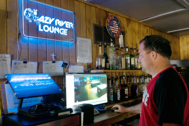 Jeff Fenton pulls up the security footage of OIU agents the night they inspected his bar.