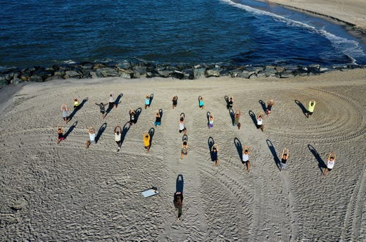 An aerial view of members of the Jetty Fitness Club training with what they call a