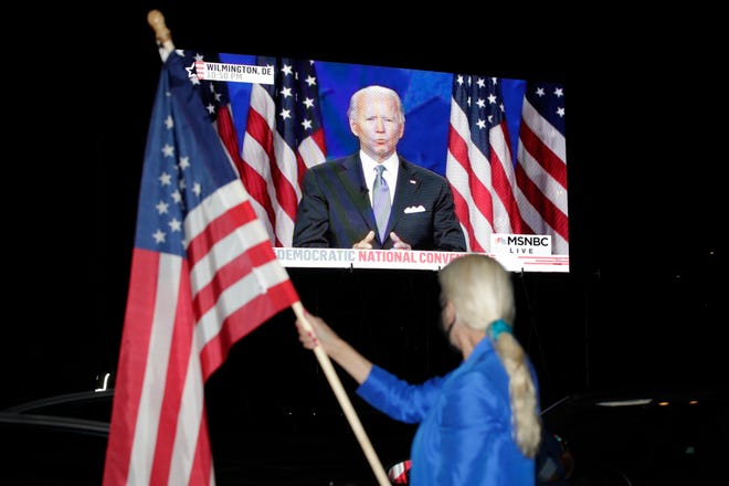 Democratic presidential nominee Joe Biden on a screen at a drive-in theater watch party during the final night of the Democratic National Convention, on Aug. 20, 2020, in Washington.