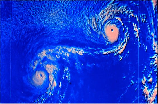 An example of the Fujiwhara effect occurred in 1974, when  Hurricanes Ione and Kirsten spun about each other in the eastern Pacific. This satellite image shows Ione on the left and Kirsten on the right.