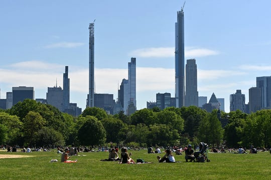 People sit on The Great Lawn in Central Park on Memorial Day during the coronavirus pandemic on May 25, 2020 in New York City.
