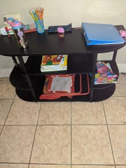 Shari Loveless made a desk for her daughter using a TV stand after having difficulty finding a desk.
