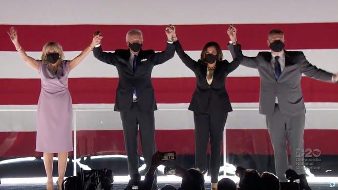 2020 Democratic Nominee for President, Joe Biden celebrates with Dr. Jill Biden, left, Sen. Kamala Harris of California, and her husband Douglas Emhoff, right, after accepting his parties' nomination to be President during the Democratic National Convention at the Chase Center in Wilmington, Delaware.