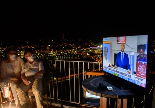 PITTSBURGH, PA - AUGUST 18: Guests watch television coverage of the Democratic National Convention at a virtual DNC party overlooking the city on August 18, 2020 in Pittsburgh, Pennsylvania. The convention, which was once expected to draw 50,000 people to Milwaukee, Wisconsin, is now taking place virtually due to the coronavirus (COVID-19) pandemic. (Photo by Jeff Swensen/Getty Images) ORG XMIT: 775548277 ORIG FILE ID: 1228100578