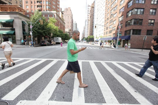 Neville Clubwala, a TaskRabbit worker in New York City, delivers cupcakes in 2012.