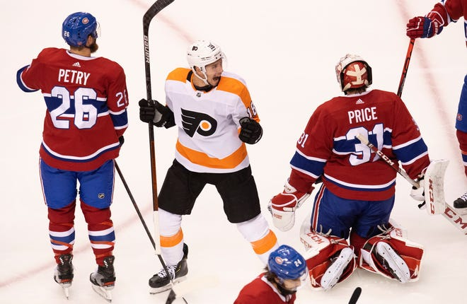 Canadiens goalie Carey Price, right, and teammate Jeff Petry react as Tyler Pitlick celebrates the Flyers' second goal Friday night.