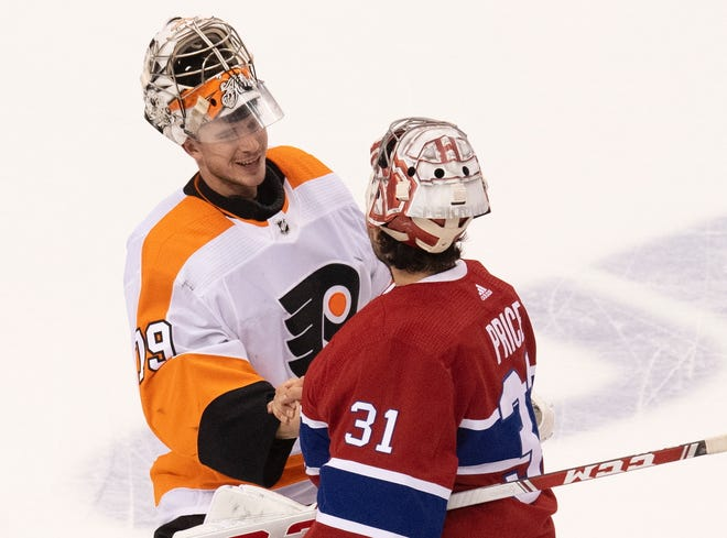 Flyers goaltender Carter Hart, left, and Canadiens goalie Carey Price shake hands after the teams' playoff series.