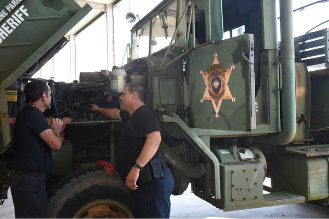 Sgt. Rudy Robichaux and Lt. Robbie Dupre check TPSO's high-water rescue trucks to be sure they are ready to roll if needed.