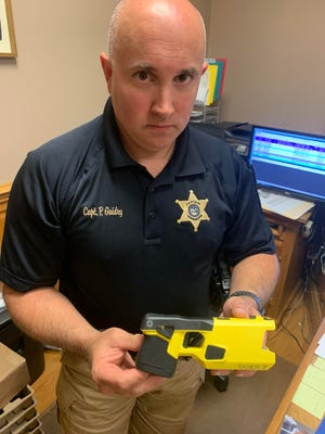 Capt. Peter Guidry shows off one of the new Tasers purchased by the Terrebonne Parish Sheriff's Office.