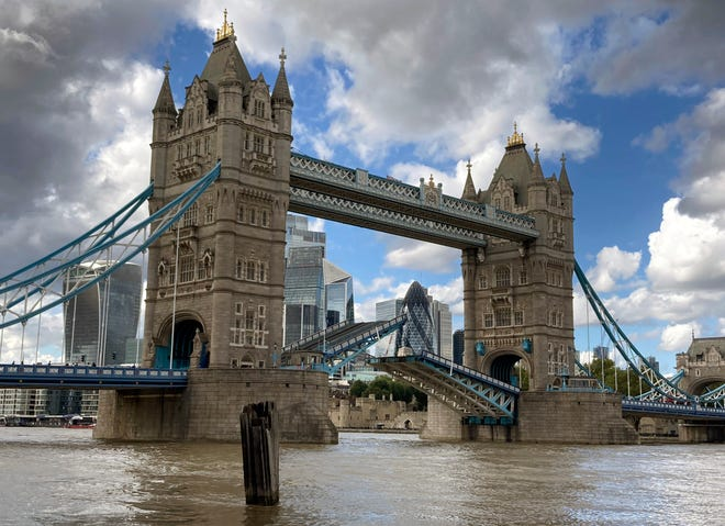 Tower Bridge crossing the River Thames is stuck open, leaving traffic in chaos and onlookers stunned as the iconic river crossing remains open in London on Saturday.  The historic bridge has failed to close Saturday after opening to allow ships to pass underneath on the River Thames.