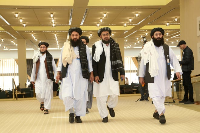 Afghanistan's Taliban delegation arrive in February for the agreement signing between Taliban and U.S. officials in Doha, Qatar. Taliban officials said in July that the son of the movement's feared founder has been put in charge of its military wing and added powerful figures to its negotiating team ahead of expected talks aimed at ending Afghanistan's decades of war, The moves mark one of the most significant shake-ups in years.