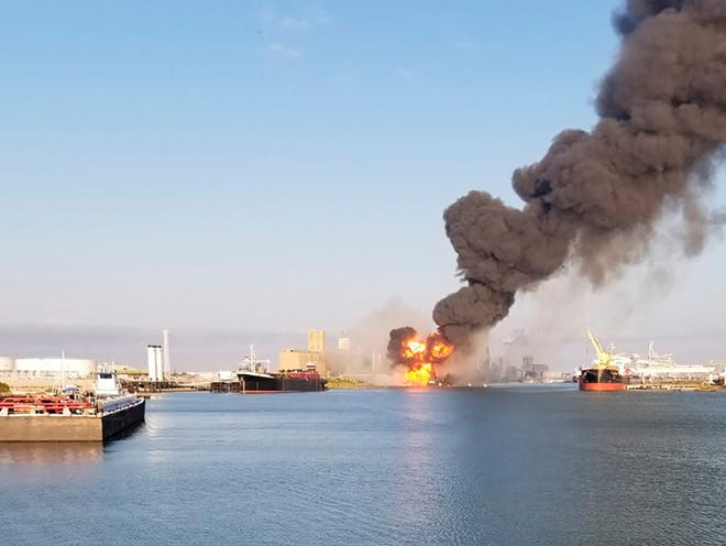 Coast Guard crews respond to a dredge on fire in the Port of Corpus Christi Ship Channel on Friday in Corpus Christi, Texas. Authorities said several people have been hospitalized after an explosion at the Texas port when a dredging vessel hit a natural gas pipeline in the water.