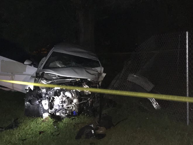 Florida Highway Patrol troopers said a 33-year-old man was behind the wheel of this car when it struck three objects, one of them a tree, early Saturday morning.