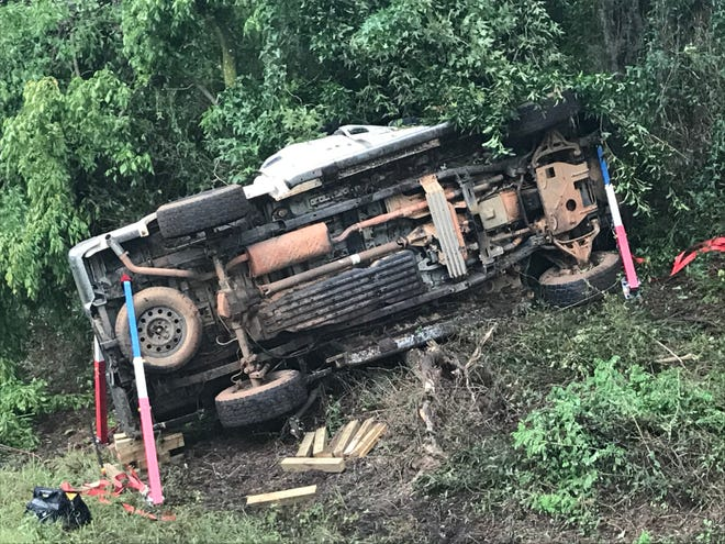 The overturned pickup truck that crashed on Interstate 75 Friday, killing a man from Alabama. The single-vehicle wreck slowed traffic on the highway considerably as troopers and emergency medical services worked the scene.