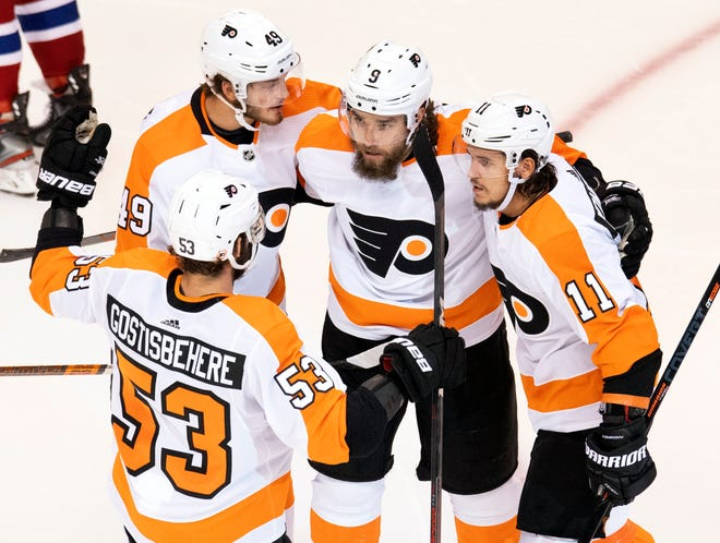 Philadelphia's Shayne Gostisbehere (53), Joel Farabee (49), Ivan Provorov and Travis Konecny (11) celebrate after Provorov scored their first goal in Friday's 3-2 win against the Montreal Canadiens. [Frank Gunn/The Canadian Press via AP]