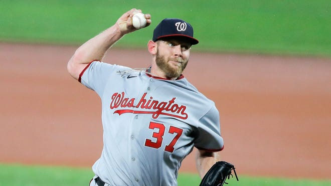 Washington Nationals pitcher Stephen Strasburg was 0-1 this season with a 10.80 ERA in two starts before his season ended because of an injury to his pitching hand. [AP Photo/Julio Cortez]