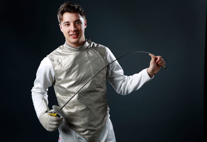 Former Stanford and Olympic fencer Alex Massialas poses at the 2016 Team USA Media Summit in Beverly Hills, Calif. Men's and women's fencing are among the 11 sports Stanford cut last month for budgetary reasons. [AP Photo/Damian Dovarganes, 2016]